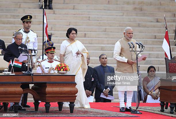 Leader Narendra Modi takes oath as the 15th Prime Minister of India at a ceremony at Rashtrapati Bhavan on May 26 2014 in New Delhi India 63yearold...