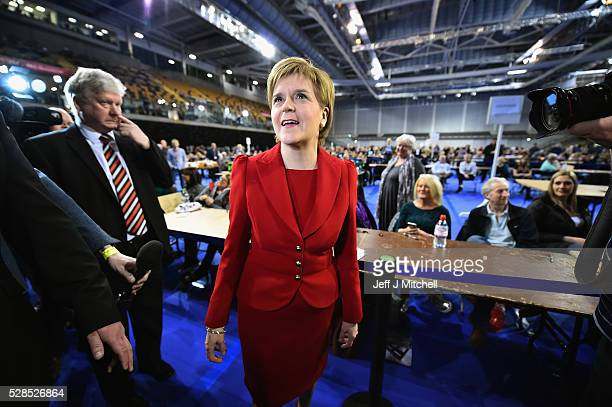 SNP leader Nicola Sturgeon arrives with Humza Yousaf at the count for the Scottish Parliament elections at the Emirates Arena on May 6 2016 in...