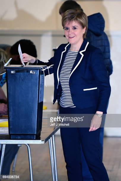 Leader Nicola Sturgeon casting her vote in the general election at Broomhouse Community Hall on June 8 2017 in Glasgow ScotlandMillions of people...