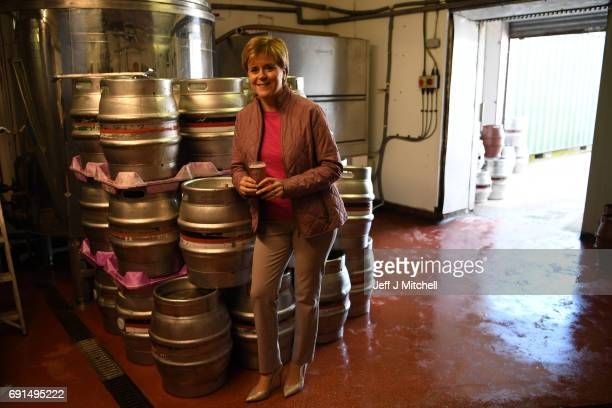 SNP leader Nicola Sturgeon has a pint of beer while taking a tour of Kelburn Brewery while campaigning for the General Election on June 2 2017 in...