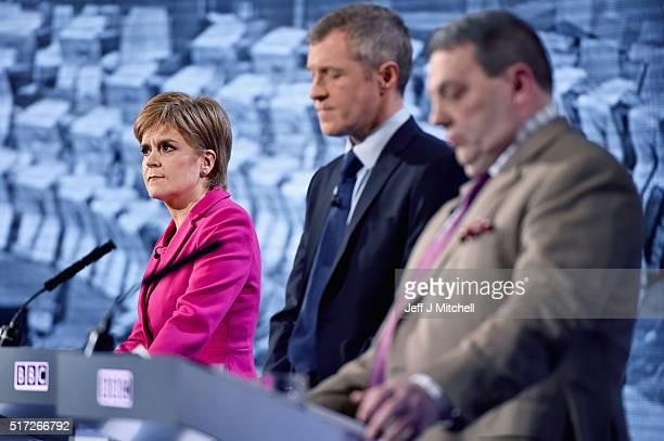SNP leader Nicola Sturgeon Lib Dem Willie Rennie and UKIP's David Coburn attend the BBC Scotland Holyrood Election debate on March 24 2016 in Glasgow...
