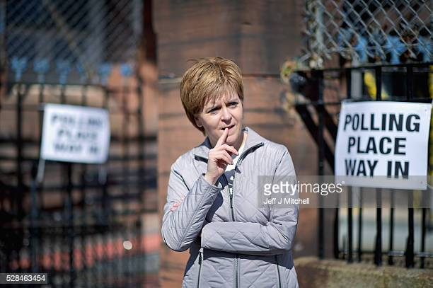 Leader Nicola Sturgeon returns to her constituency to meet voters on May 5 2016 in GlasgowScotland Today dubbed 'Super Thursday' sees the British...