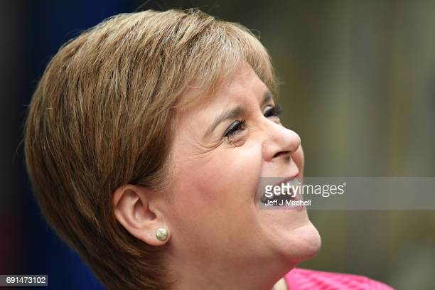 SNP leader Nicola Sturgeon smiles looking up while campaigning for the General Election at Bubbles Factory on June 2 2017 in Carluke South...