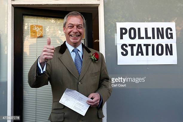 UKIP leader Nigel Farage arrives to cast his vote for the South Thanet constituency on May 7 2015 in Ramsgate England The United Kingdom has gone to...