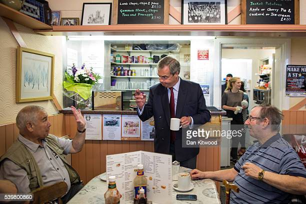 UKIP leader Nigel Farage speaks to members of the public as the eat their breakfast in a cafe while having a walk about on June 13 2016 in Ramsgate...