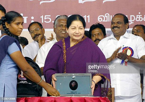 Leader of All India Anna Dravida Munnetra Kazhagam party and Chief Minister of the southern Indian state of Tamil Nadu J Jayalalithaa presents a...