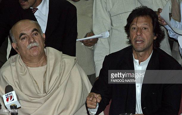 Leader of All Parties Democratic Movement Alliance Imran Khan is watched by Asfandyar Wali as he addresses a press conference in Islamabad 24...