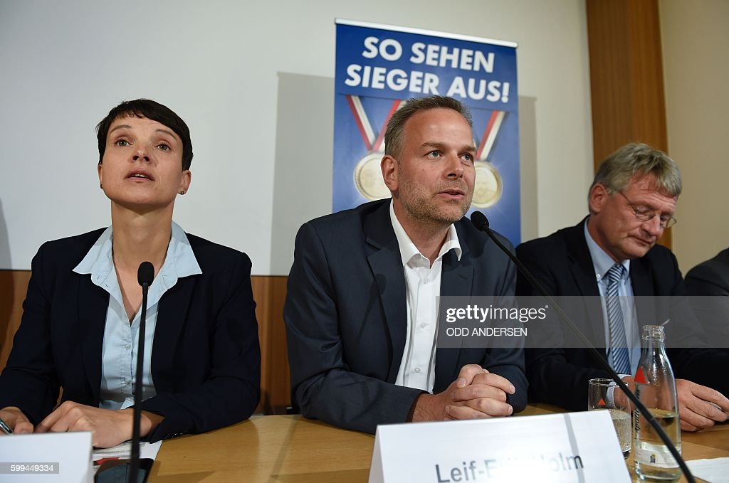 Leader of 'Alternative for Germany' (AfD) Frauke Petry, top candidate for the AFD in Mecklenburg-Western Vorpommern Leif-Erik Holm and parliamentary group leader of the AFD Joerg Meuthen attend a press conference in Berlin, on September 5, 2016 on day after the regional state elections in Mecklenburg-Western Vorpommern. The right-wing populist Alternative for Germany (AfD) party clinched almost 21 percent in its first bid for seats in the regional parliament of Mecklenburg-Western Pomerania. / AFP / ODD