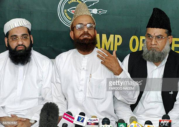 Leader of an alliance of Pakistani Islamic schools Munibur Rehman addresses a press conference along with alliance leaders after a meeting with...