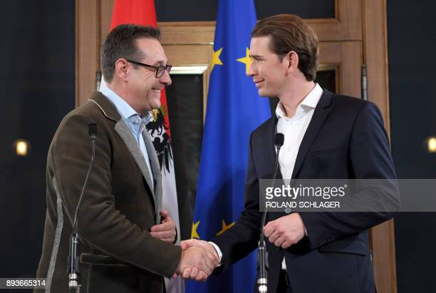 Leader of Austria's conservative People's Party Sebastian Kurz shakes hands with Chairman of the Freedom Party HeinzChristian Strache after a joint...