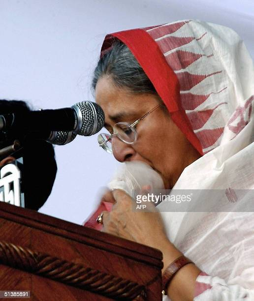 Leader of Bangladesh's main opposition party the Awami League Sheikh Hasina Wajed weeps during her speech at a rally in Dhaka 03 October 2004...