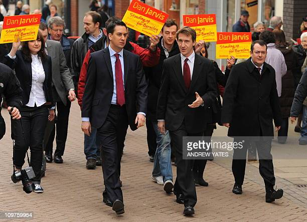Leader of Britain's opposition Labour Party Ed Miliband and newlyelected Member of Parliament Dan Jarvis walks around Peel Square during a visit to...