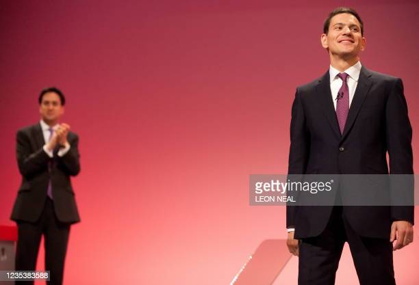 Leader of Britain's opposition Labour Party, Ed Miliband , applauds his brother David Miliband, after his address to delegates on the second day of...
