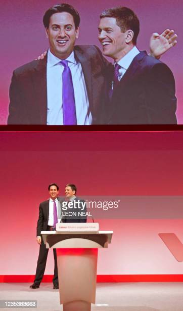 Leader of Britain's opposition Labour Party, Ed Miliband, congratulates his brother David Miliband, after his address to delegates on the second day...