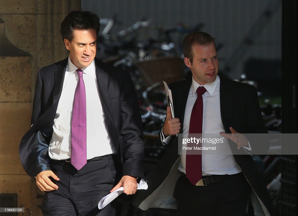 Leader of Britain's opposition Labour party, Ed Miliband (L) leaves Parliament with an advisor on August 29, 2013 in London, England. Prime Minister David Cameron has recalled Parliament to debate the UK's response to a suspected chemical weapon attack in Syria.
