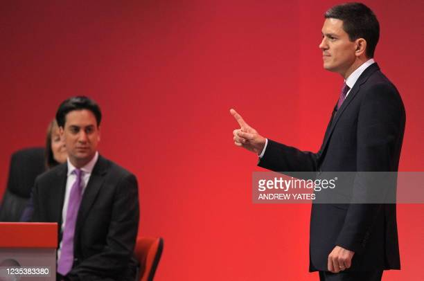 Leader of Britain's opposition Labour Party, Ed Miliband , listens as he brother David Miliband speaks on the second day of the annual Labour Party...