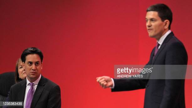 Leader of Britain's opposition Labour Party, Ed Miliband , listens as his brother David Miliband addresses delegates, on the second day of the annual...