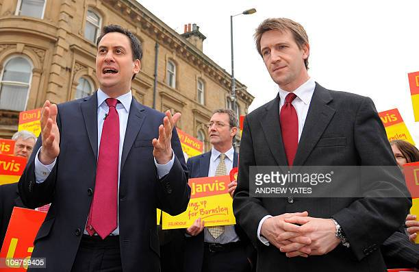 Leader of Britain's opposition Labour Party Ed Miliband speaks as newlyelected Member of Parliament Dan Jarvis looks on during his visit to Barnsley...