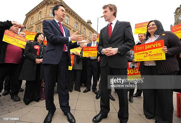 Leader of Britain's opposition Labour Party Ed Miliband speaks as newlyelected Member of Parliament Dan Jarvis looks on during a visit to Barnsley in...