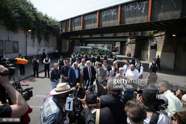 Leader of Britain's opposition Labour Party Jeremy Corbyn stands with members of local Faith groups after they gave a statement to the media near the...