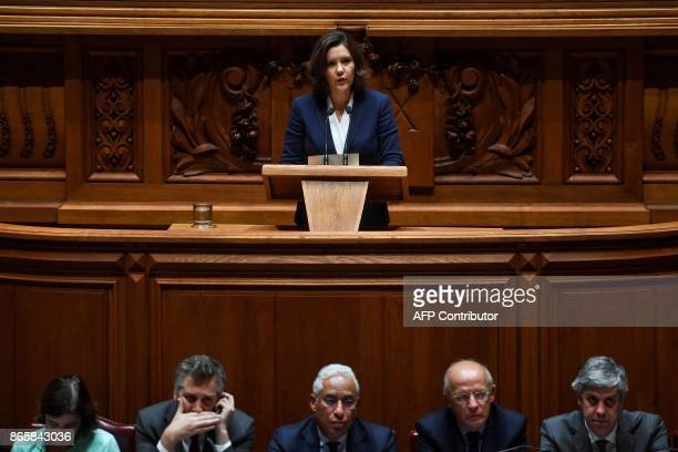 Leader of CDSPP party Assuncao Cristas delivers a speech as member of the government sit below during the debate of a censure motion tabled by the...