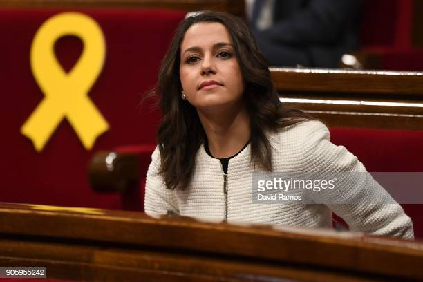 Leader of Ciudadanos party Ines Arrimadas looks on next to yellow ribbons in memory of elected members of the parliament still in custody in jail in...