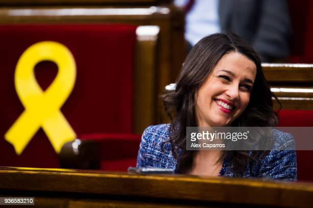 Leader of Ciudadanos party Ines Arrimadas reacts next to yellow ribbons in memory of elected members of the parliament still in custody in jail in...