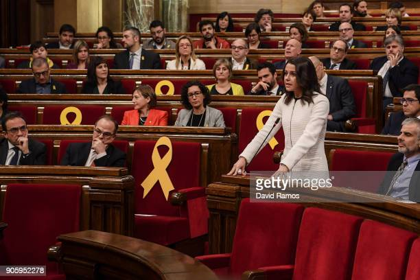 Leader of Ciudadanos party Ines Arrimadas speaks next to yellow ribbons in memory of elected members of the parliament still in custody in jail in...