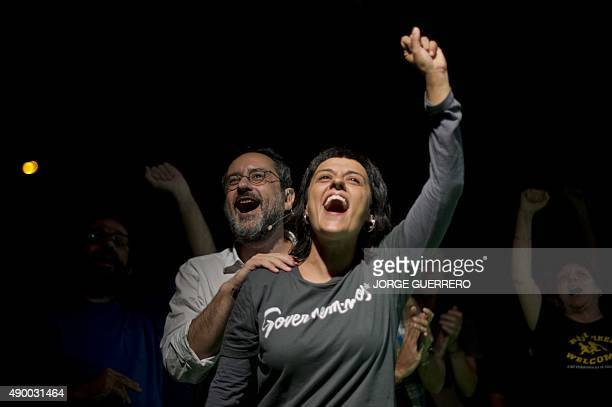 Leader of CUP political party Antonio Banos and CUP member Anna Gabriel sing at the end of the party's final campaign meeting for the regional...