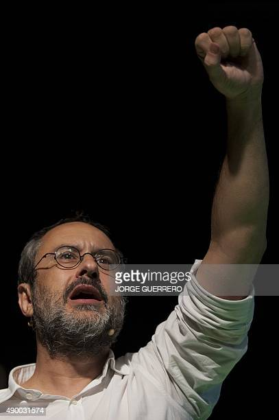 Leader of CUP political party Antonio Banos raises his arm at the end of the party's final campaign meeting for the regional election in Badalona on...