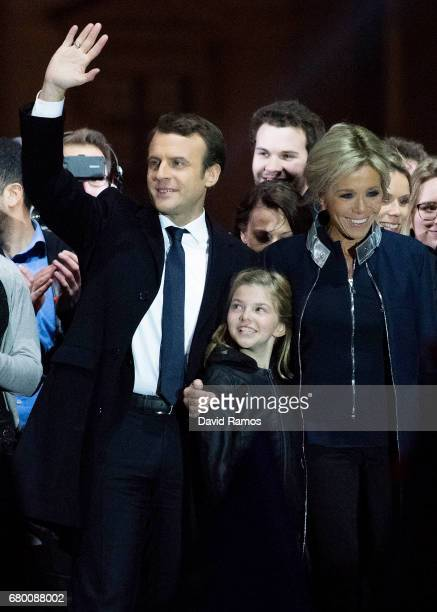 Leader of 'En Marche ' Emmanuel Macron addresses supporters with wife Brigitte Trogneux after winning the French Presidential Election at The Louvre...