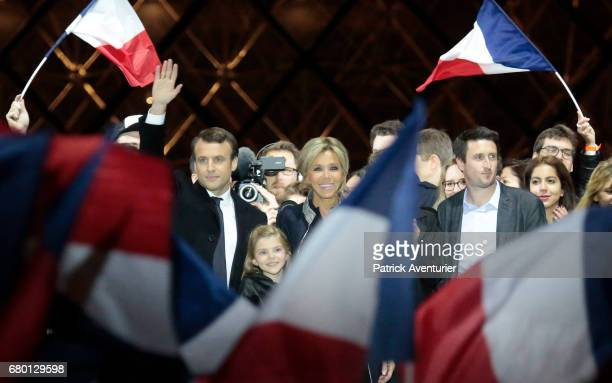 Leader of 'En Marche ' Emmanuel Macron and his wife Brigitte acknowledge supporters after winning the French Presidential Election at The Louvre on...