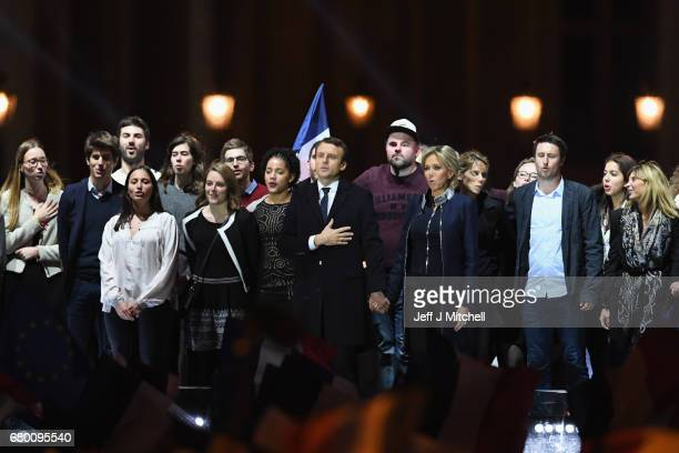 Leader of 'En Marche ' Emmanuel Macron and his wife Brigitte acknowlege supporters after winning the French Presidential Election at The Louvre on...