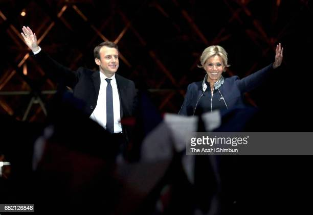 Leader of 'En Marche ' Emmanuel Macron and his wife Brigitte to supporters after winning the French Presidential Election at The Louvre on May 7 2017...