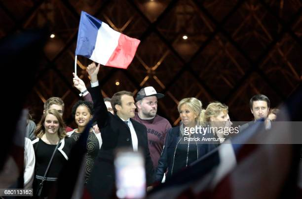 Leader of 'En Marche ' Emmanuel Macron and his wife Brigitte wave to supporters after winning the French Presidential Election at The Louvre on May 7...