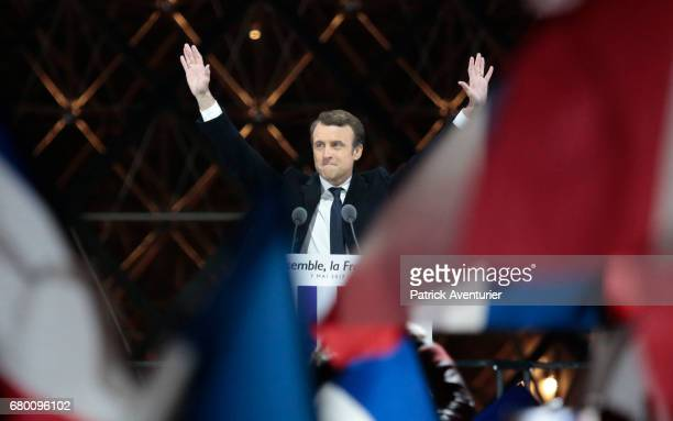 Leader of 'En Marche ' Emmanuel Macron wave to supporters after winning the French Presidential Election at The Louvre on May 7 2017 in Paris...