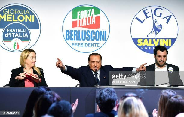 TOPSHOT Leader of farright party Brothers of Italy Giorgia Meloni head of the centreright Forza Italia Silvio Berlusconi and leader of farright party...