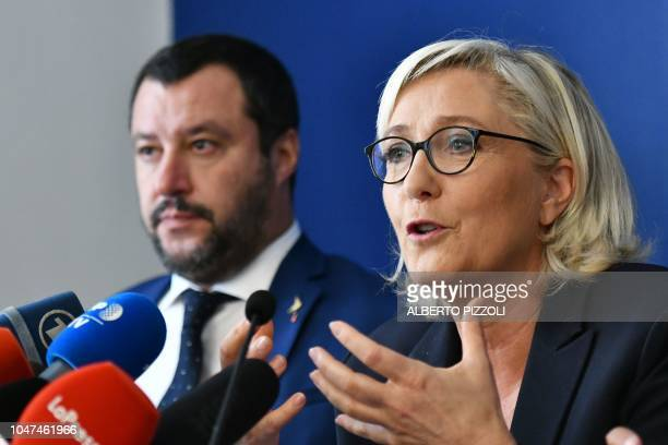 Leader of France's farright National Rally party Marine Le Pen speaks as Italy's Interior minister Matteo Salvini looks on during a press conference...