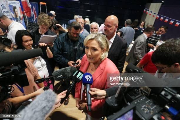 Leader of France's Rassemblement National farright political party Marine Le Pen talks to journalists during RN party's fair Fete du drapeau on...