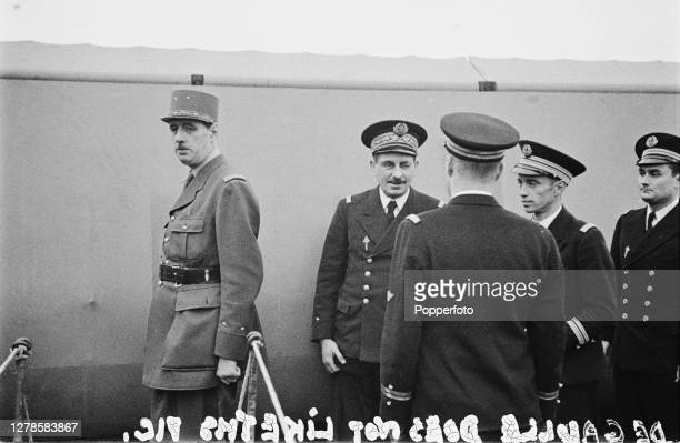 Leader of Free France General Charles de Gaulle and Admiral Emile Muselier of the Free French Naval Forces inspect the crew on the deck of the French...