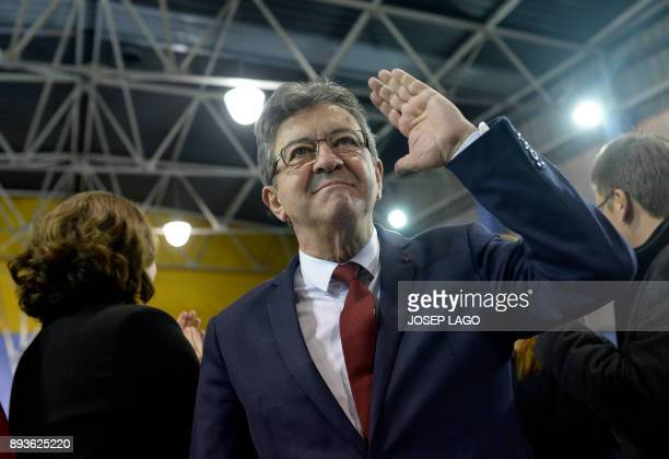 Leader of French leftist party 'La France insoumise' JeanLuc Melenchon waves as he arrives to take part in a campaign meeting of 'Catalunya en comu...
