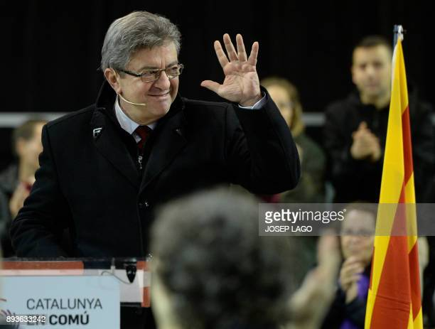 Leader of French leftist party 'La France insoumise' JeanLuc Melenchon waves as he takes part in a campaign meeting of 'Catalunya en comu podem'...