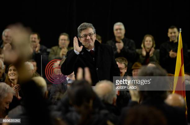 Leader of French leftist party 'La France insoumise' JeanLuc Melenchon waves during a campaign meeting of 'Catalunya en comu podem' electoral...