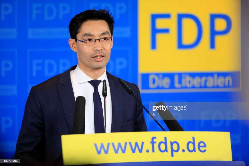 Leader of Germany's Free Democratic party (FDP) and Economy Minister Philipp Roesler speaks at the FDP headquarter in Berlin on January 20, 2013 on polling day of the local elections in the central German state of Lower Saxony. The vote is largely seen as a test run for Chancellor Angela Merkel, her rivals and would-be heirs, eight months before nationwide polls. German Chancellor Angela Merkel's party was ahead after the first state poll in a general election year, exit polls indicated, but it was unclear whether its coalition would cling to power.