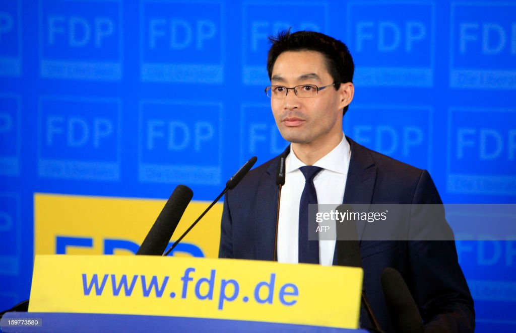 Leader of Germany's Free Democratic party (FDP) and Economy Minister Philipp Roesler arrives at the FDP headquarter in Berlin on January 20, 2013 on polling day of the local elections in the central German state of Lower Saxony. The vote is largely seen as a test run for Chancellor Angela Merkel, her rivals and would-be heirs, eight months before nationwide polls. German Chancellor Angela Merkel's party was ahead after the first state poll in a general election year, exit polls indicated, but it was unclear whether its coalition would cling to power.