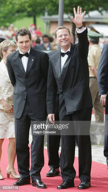 Leader of Germany's Free Democrats Guido Westerwelle and his partner Michael Mronz arrive for the opening performance of Richard Wagner's Tristan and...
