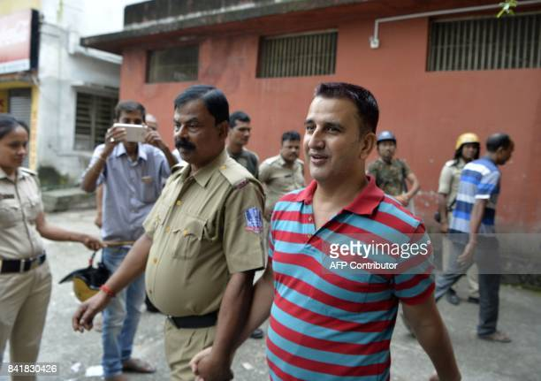 Leader of Gorkha Janamukti Morcha Hemat Gautam is escorted by West Bengal police following his arrest on Septmeber 1 during court proceedings in...