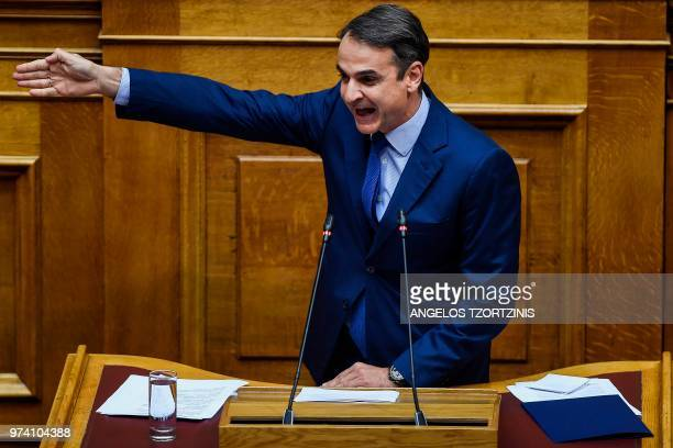 Leader of Greek main opposition New Democracy party Kyriakos Mitsotakis speaks during a parliamentary session in Athens on June 14 as the Greek...
