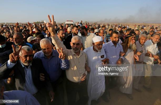 Leader of Hamas in the Gaza Strip Yahya Sinwar takes part in the Great March of Return demonstration near IsraelGaza border in Khan Yunis Gaza on...