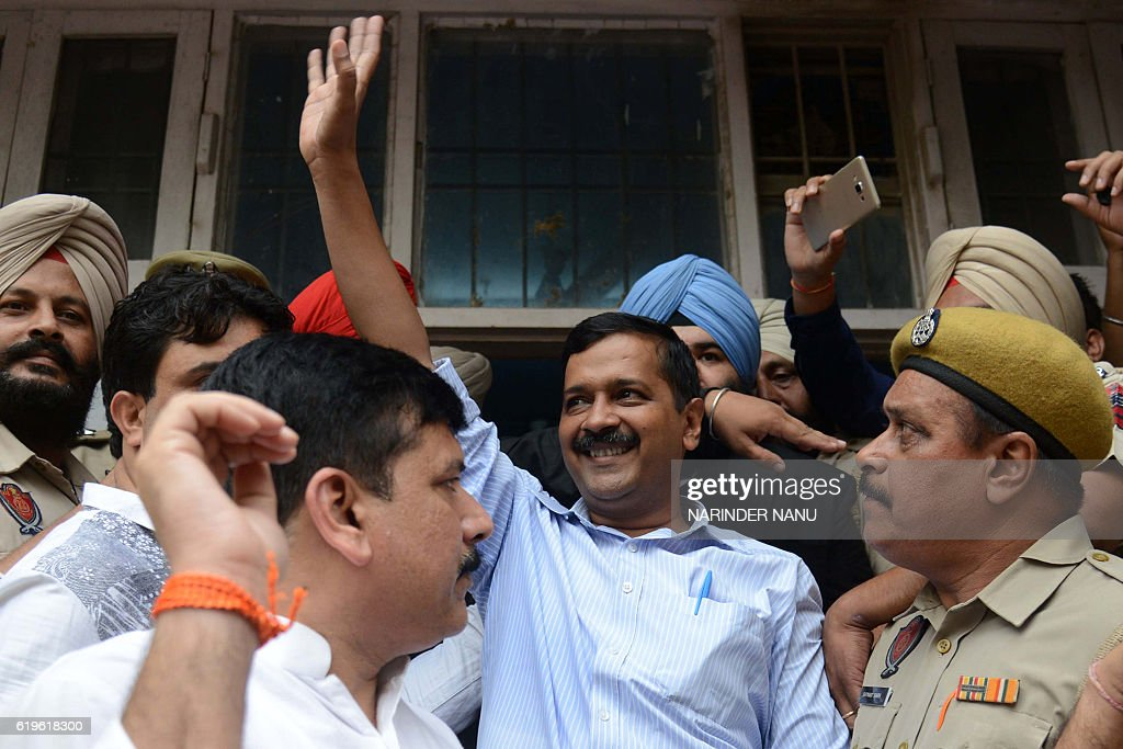 Leader of India`s Aam Aadmi Party and Chief Minister of Delhi Arvind Kejriwal waves as he leaves after a hearing at the district court in Amritsar on.